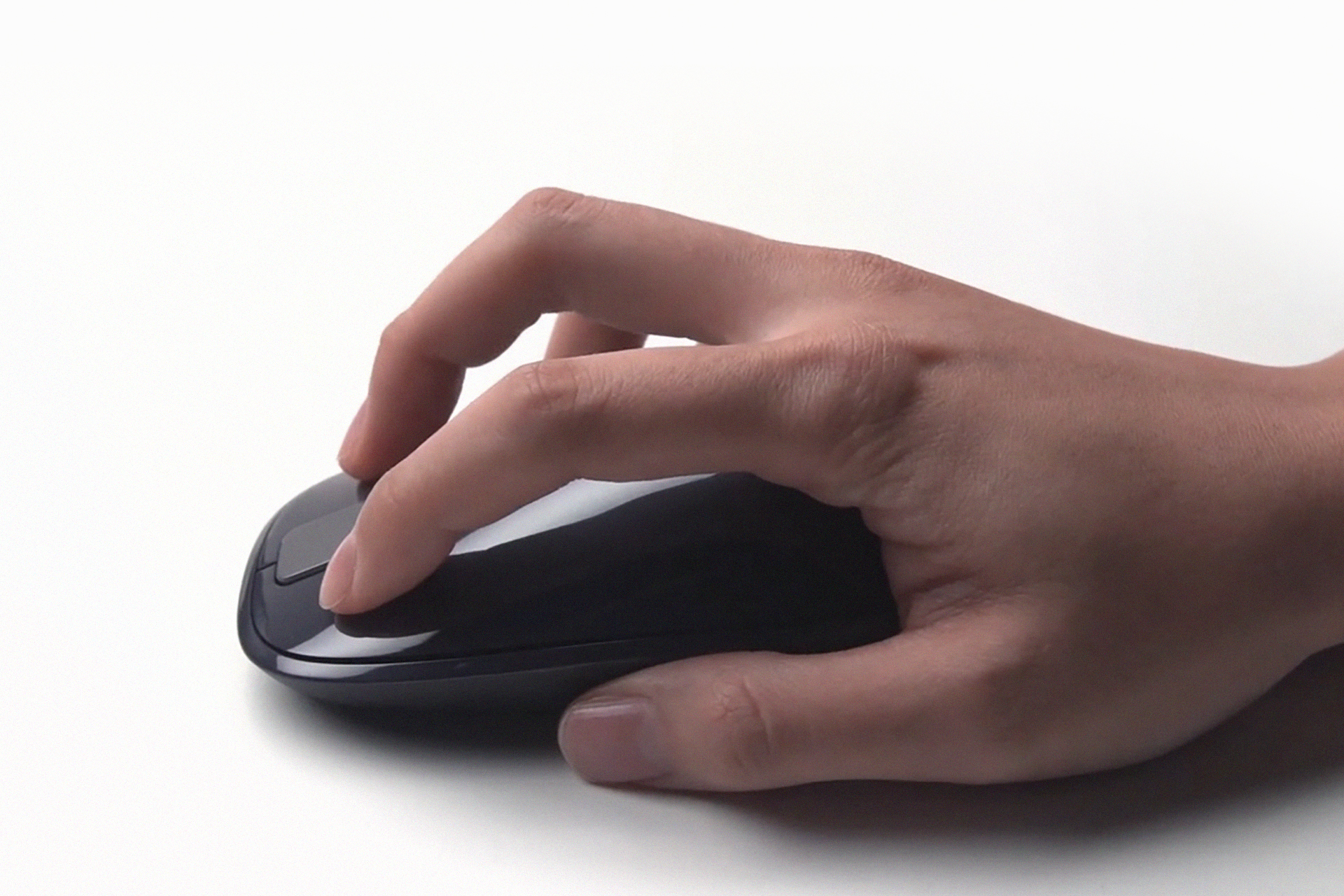 Microsoft Explorer Touch Mouse in a hand