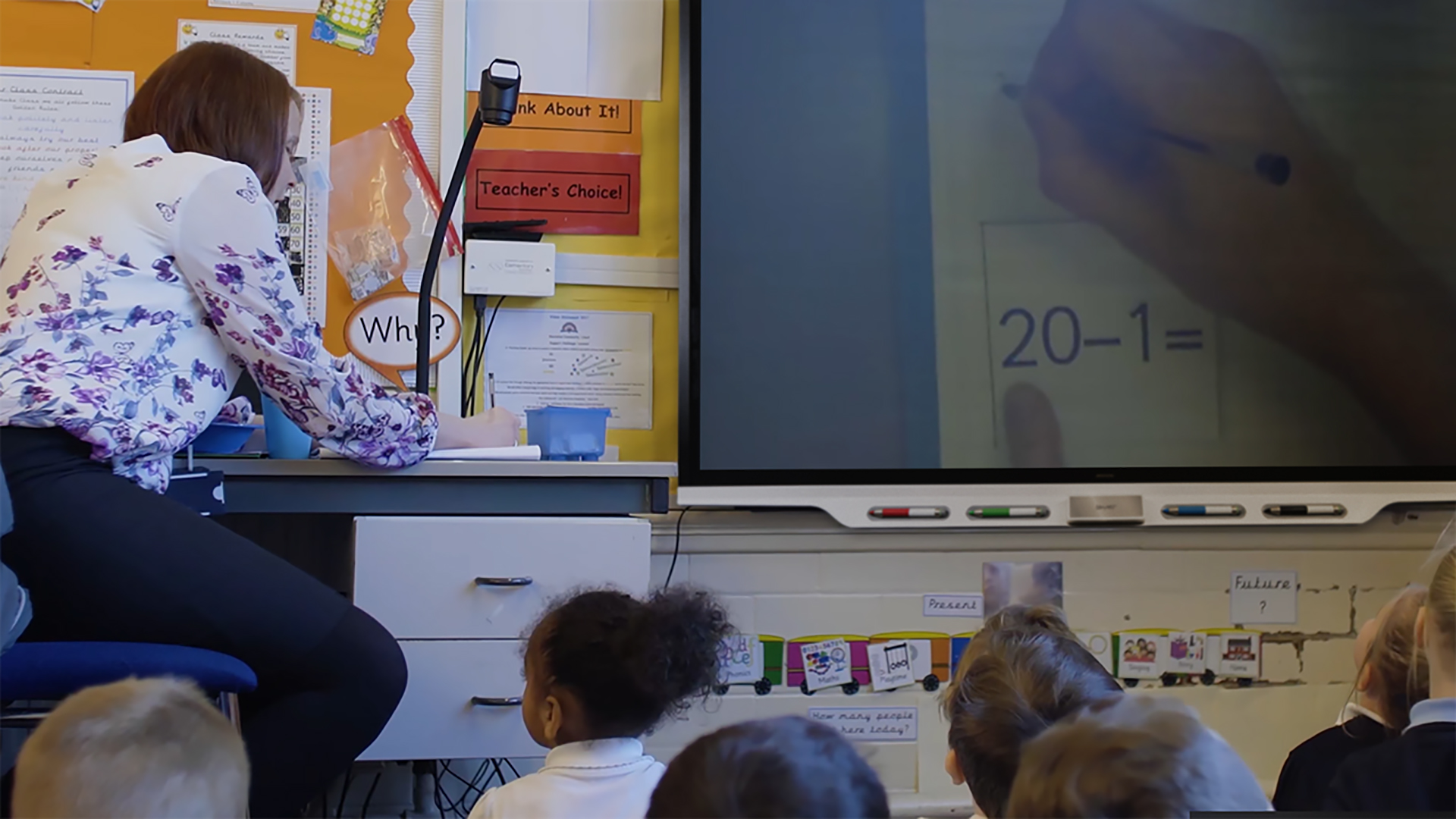 Teacher using the SMART Board 7000 series with a doc camera within a classroom